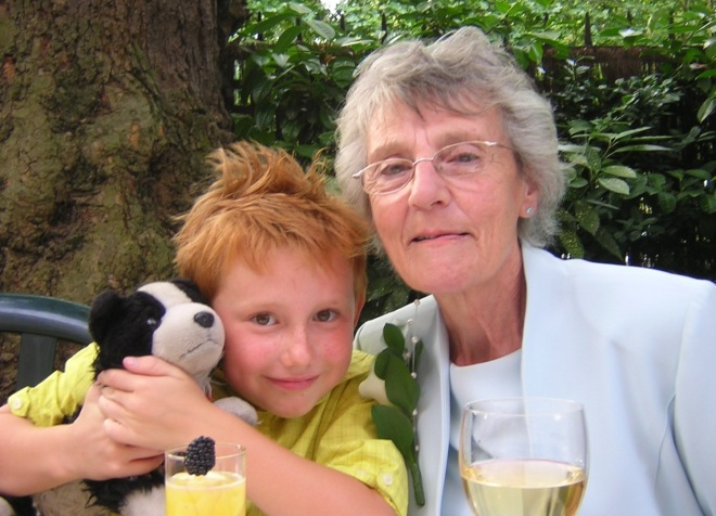 My mum, son and Wham (hint, he's the black and white one) at my brother's wedding. July 8 2006