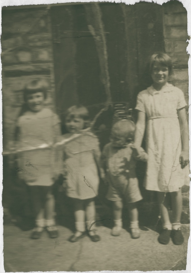 Three little girls pose for the camera with one little boy (my Dad) whose attention is elsewhere. I wonder what he was looking at? Photo: c. 1933 Leslie family archive.
